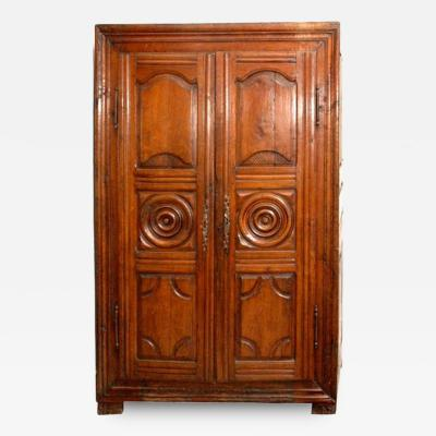 Armoire in Cherry Wood with Carved Panels Roundels and Iron Hardware