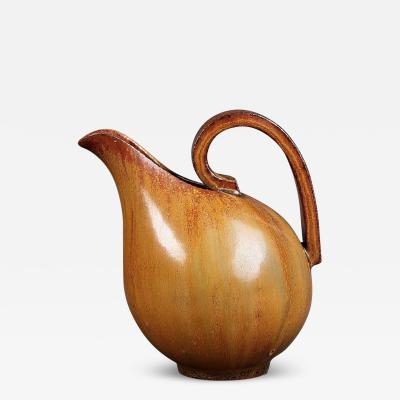 Arne Bang Jug with handle decorated with brown glaze