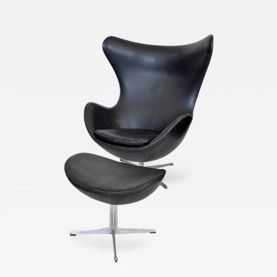 Arne Jacobsen Early Original Black Leather Egg Chair and Ottoman by Arne Jacobsen