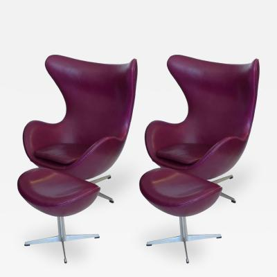 Arne Jacobsen Pair of Original Mulberry Leather Egg Chairs with Ottomans by Arne Jacobsen