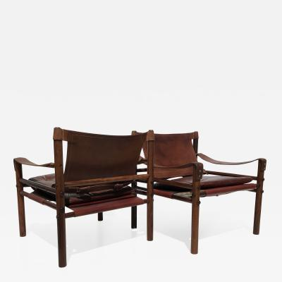 Arne Norell Pair of Arne Norell Rosewood Sirocco Sfari Chairs