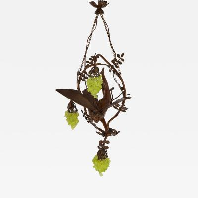 Art Nouveau period bronze and coloured glass chandelier