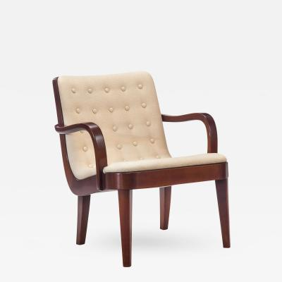 Axel Larsson Attributed A Swedish Tufted Upholstered and Beech Armchair