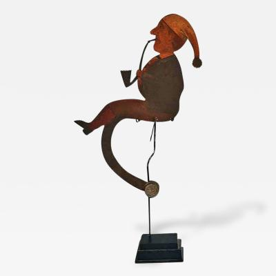 Balance Toy of a Man in Stocking Cap Smoking a Pipe