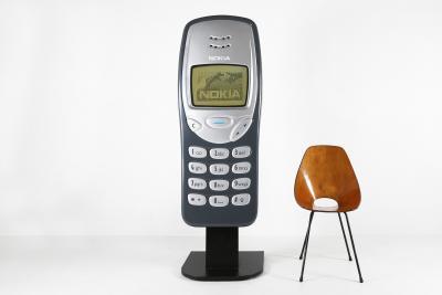 Big advertising Nokia 3210 cell phone