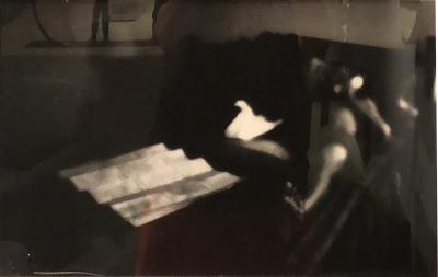 Black and White Silver Gelatin Print of a reclining man in shadows