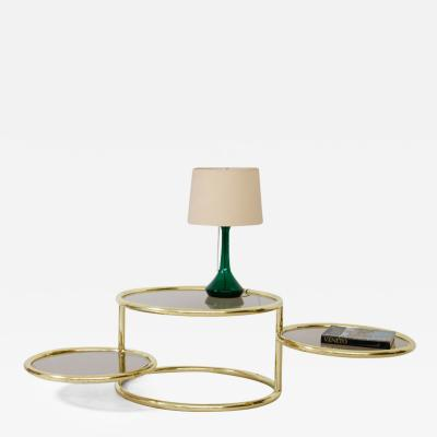 Brass coffee table with glass tops and two rotating elements