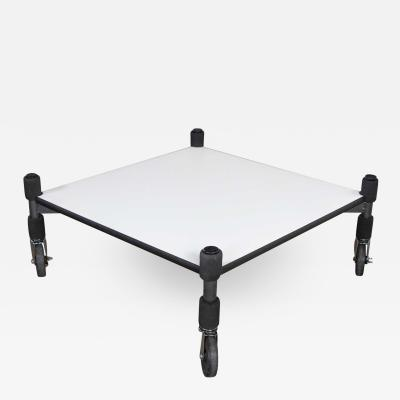 Brian Kane Post modern white laminate metal low coffee table or end table on casters