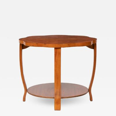 British Art Deco 2 Tier occasional Table in figured walnut with scolloped edge