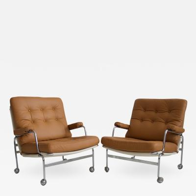 Bruno Mathsson Pair of Bruno Mathsson Brown Leather Karin Lounge Chairs
