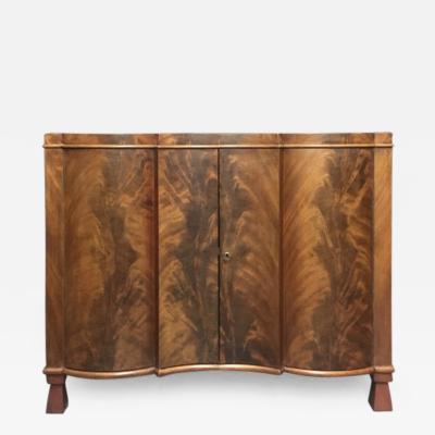Bruno Paul An Art Deco Serpentine Front Mahogany Cabinet