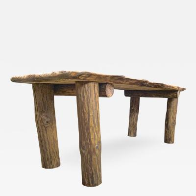 Brutalist awesome sand blasted organic dinning table with log legs