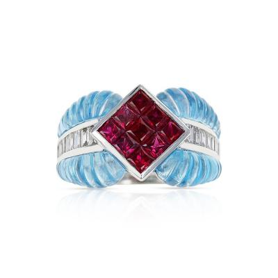 CARVED BLUE TOPAZ RING WITH 1 40 CT RUBY SET WITH 0 46 CTS DIAMONDS 18K GOLD
