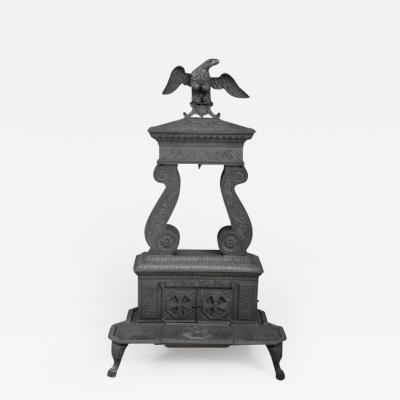 CAST IRON TWO COLUMN PARLOR STOVE WITH EAGLE FINIA