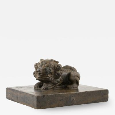 CHINESE STONE SHOEMAKERS WEIGHT WITH FOO DOG