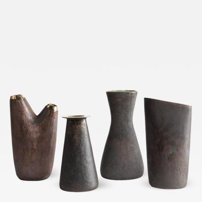 Carl Aub ck Grouping of Four Carl Aubo ck Brass Vases