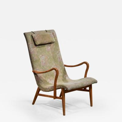 Carl Axel Acking Carl Axel Acking Lounge Chair with Aged Floral Upholstery Sweden 1940s