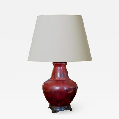 Carl Halier Exquisite table lamp in oxblood glaze with bronze mounts by Carl Halier