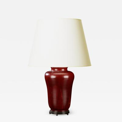 Carl Halier Exquisite table lamp with oxblood glaze and bronze stand by Carl Halier