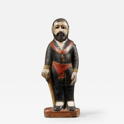 Carved alabaster and polychrome huamanga figure of a man
