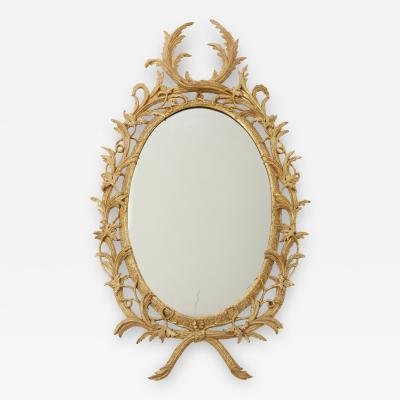 Carved and gilded rococo looking glass