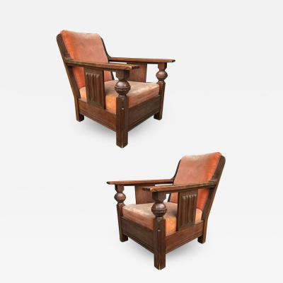 Charles Dudouyt Charles Dudouyit documented pair of rare carved oak lounge chairs