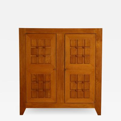 Charles Dudouyt Large oak sculpted front cabinet by Charles Dudouyt