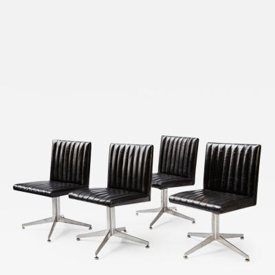 Charles Eames A Set of Four Black leather Eames Designed Herman Miller Chairs