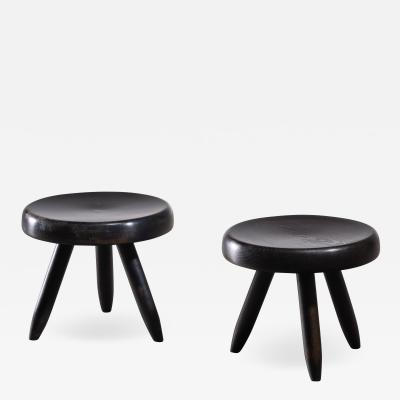 Charlotte Perriand Pair of Charlotte Perriand low black tripod stools