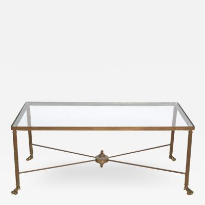 Circa 20th century Brass cocktail table with claw feet and new glass top
