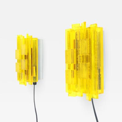 Claus Bolby Pair of acrylic yellow wall lamps by Claus Bolby for Cebo Industri 1960s