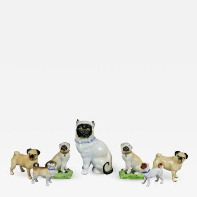 Collection Of Forty Two Pottery And Porcelain Pug Dogs