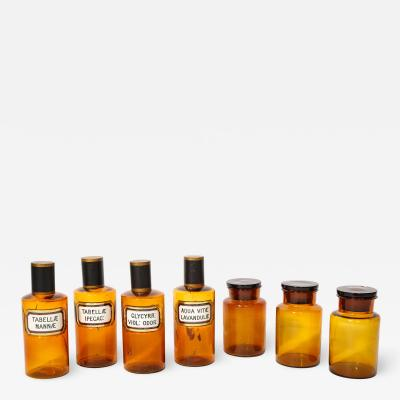 Collection of 7 Amber Glass Apothecary Jars