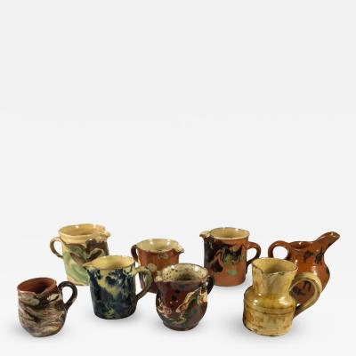 Collection of Eight Small French Provincial Jaspe Cream Pitchers 19th Century