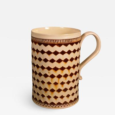 Creamware Mocha Tankard with Repeating Bands of Diamonds