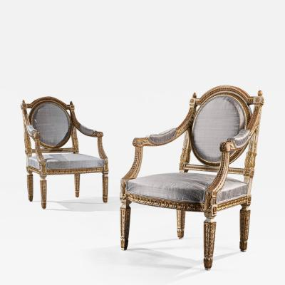 DECORATIVE ITALIAN PAINTED AND PARCEL GILT ARMCHAIRS OF NEO CLASSICAL DESIGN