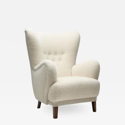 Danish Wingback Chair with Stained Beech Legs Denmark 1940s
