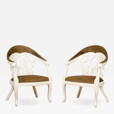 David Barrett A pair of white lacquered armchairs designed by D Barrett circa 1970