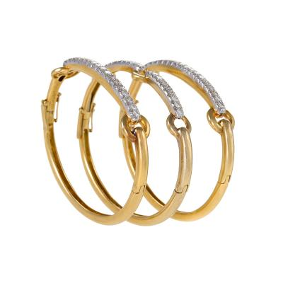 David Webb A set of three 18kt gold platinum and diamond bracelets David Webb