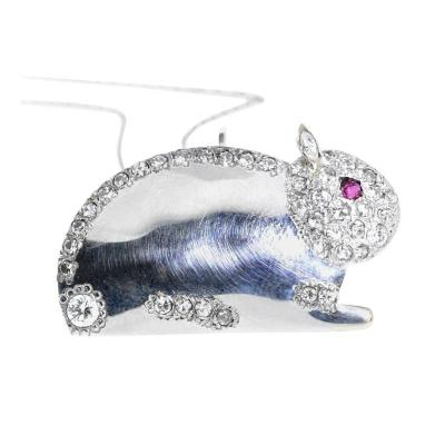 Diamonds set in 18K white gold in the motif of a bunny with a natural ruby eye