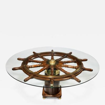 Dining table made from a 19th Century ships steering wheel