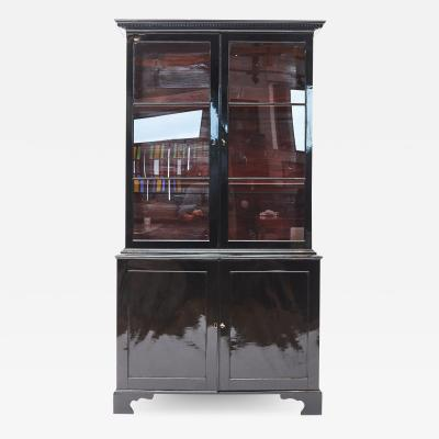 EARLY 19TH CENTURY BLACK POLISHED DISPLAY CABINET