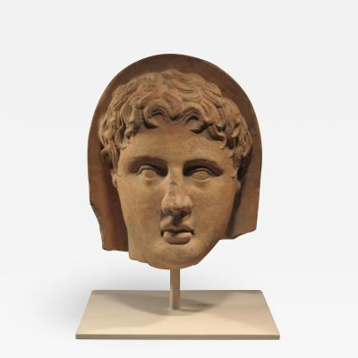 ETRUSCAN TERRACOTTA VOTIVE HEAD OF A YOUNG MAN