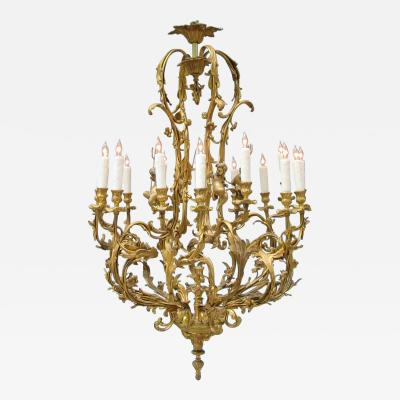 Early 20th Century French Louis XIV Bronze Dor Foliate and Putti Chandelier