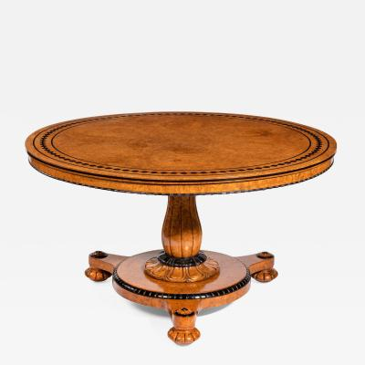 Early Victorian amboyna centre table