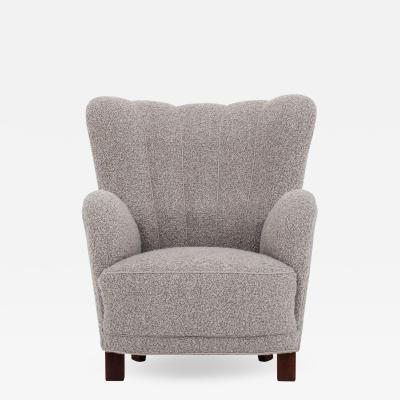 Easy chair in grey wool