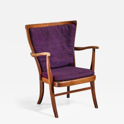 Elegant Danish Wingback Armchair with Warm Deep Purple Cushions