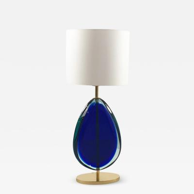 Elegant pair of glass and brass table lamps