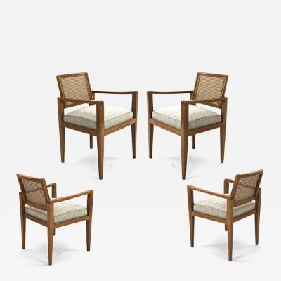 Emile Seigneur Emile Seigneur set of 4 oak cane arm chair covered in maharam boucle