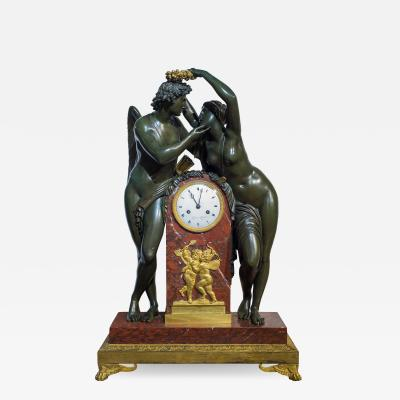Empire Ormolu Mounted Patinated Bronze and Rouge Royale Marble Mantel Clock